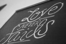 A Bible verse written on a chalkboard.