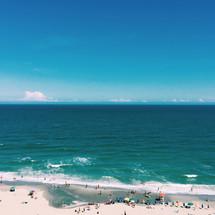 beach-goers enjoying a summer day at the beach