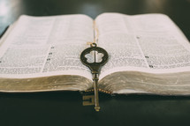 a key on the pages of a Bible