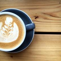 design in creamer in coffee mug