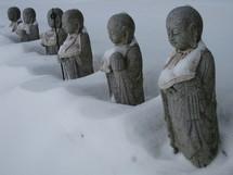 Hindu statues in snow