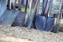 shovels in soil