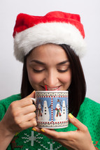 woman drinking hot cocoa at Christmas