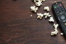 remote control and popcorn