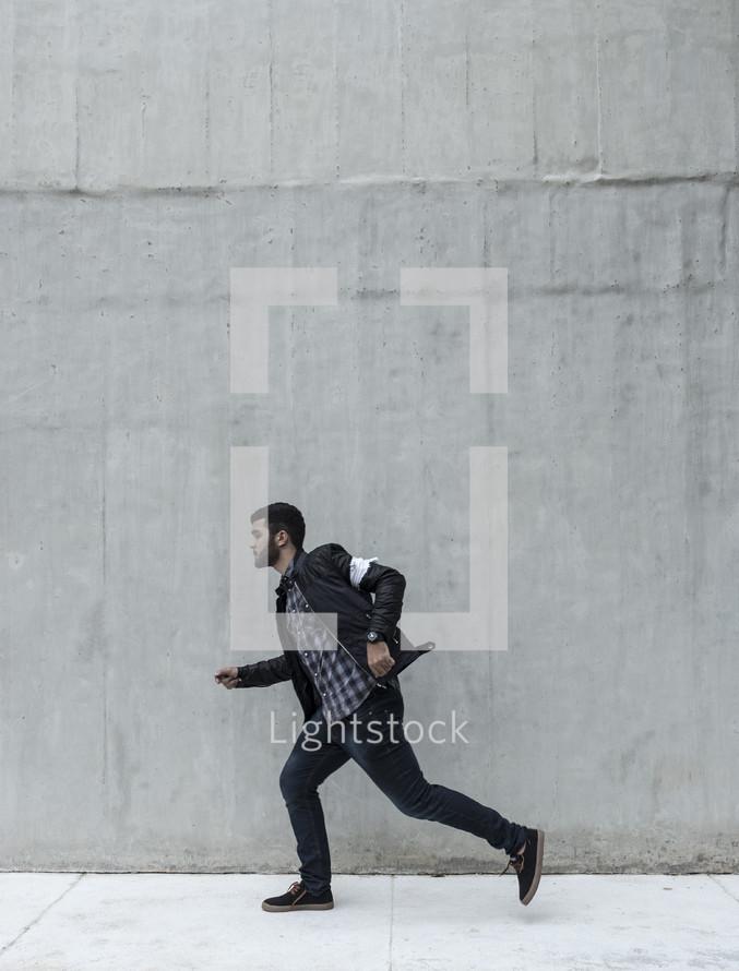 a man running down a sidewalk
