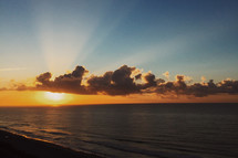 rays of sunlight over the ocean
