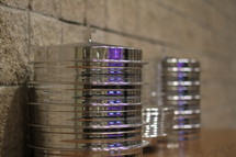Stacks of silver communion trays.