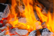 Hot embers in fire flames