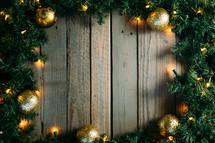gold ornaments, pine garland, Christmas lights, border
