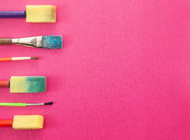 paint brushes on pink