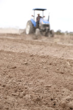 a tractor plowing a field