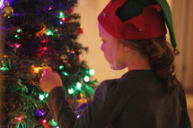 girl decorating a Christmas tree