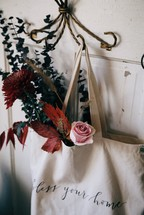 flowers in a bag hanging on a hook