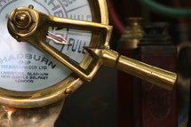 Brass ship's telegraph set on full speed ahead