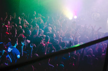 fans gathered around a stage at a concert