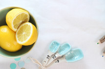 bowl of lemons, dots, measuring spoons, kitchen, cooking, pencils