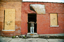 a person looking into an abandoned building