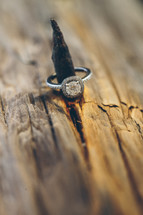engagement ring on a log