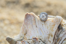 engagement ring on a seashell