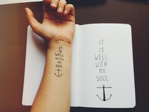 "Arm tattoo and and journal -- ""it is well with my soul."""