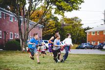 boys playing flag football