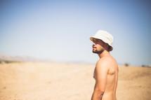 a man in a bucket hat