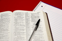 a Bible opened to Psalm 23 and a pen