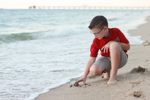 boy child playing in the sand