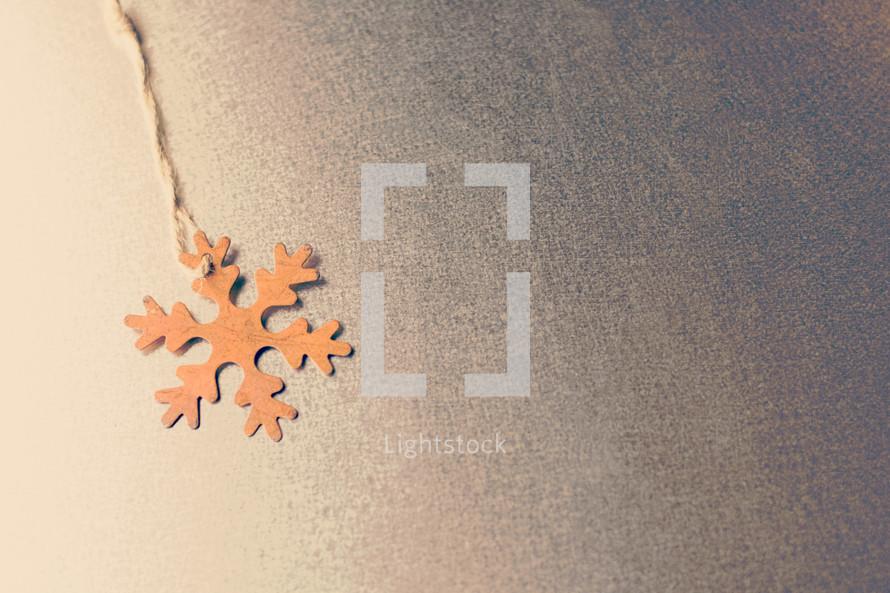 brown paper snowflake gift tag