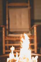 flames in a barrel and a rocking chair