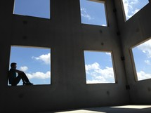 A man sitting in a window.