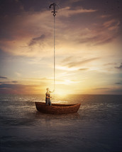 a man anchoring his boat to the sky