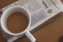 coffee mug on a newspaper