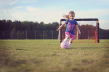 girl child playing soccer