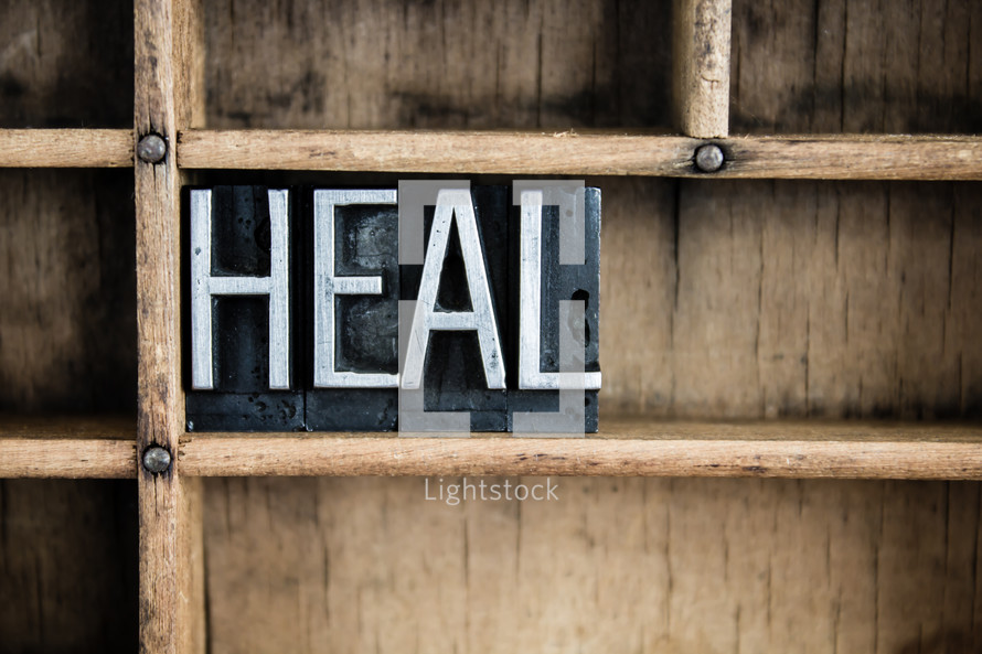 word heal on a shelf
