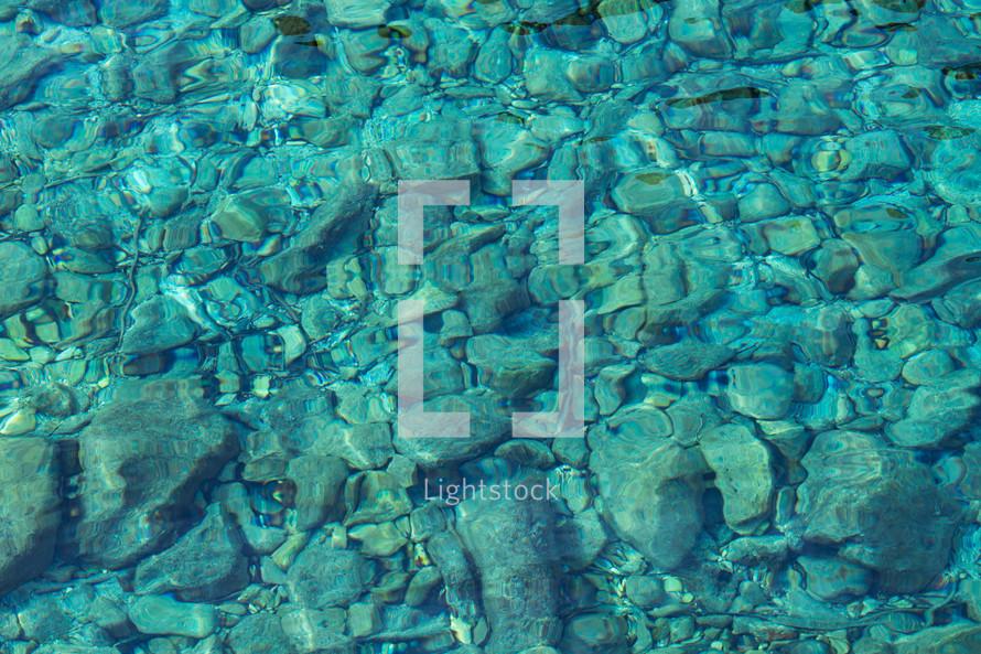 rocks under shallow water