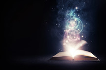 swirling light from the pages of a Bible