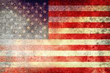American flag on rusted metal