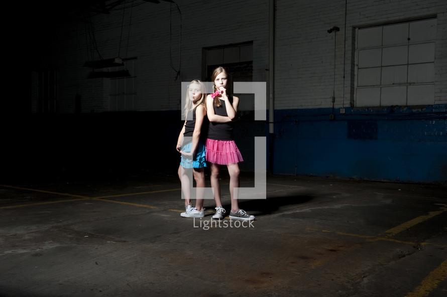 girls posing in an empty warehouse