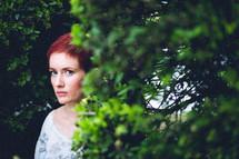 Woman standing in a garden.