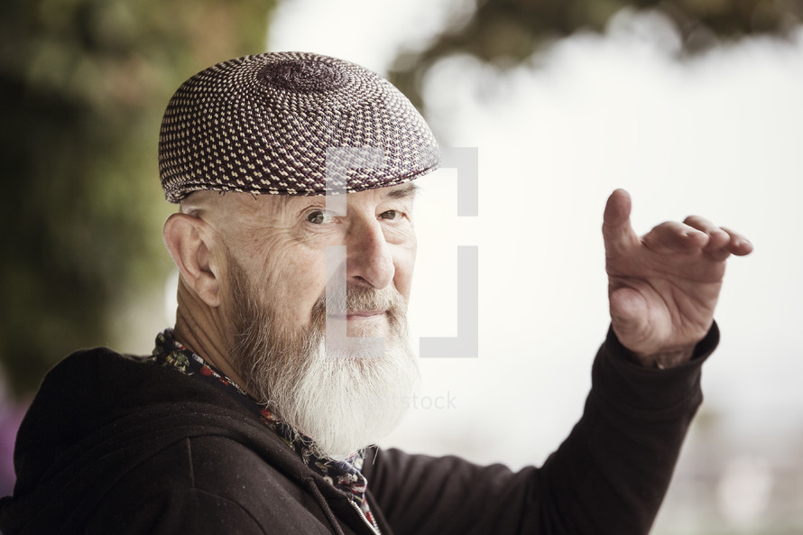 an elderly man waving hi