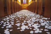 white rose petals spread down the aisle