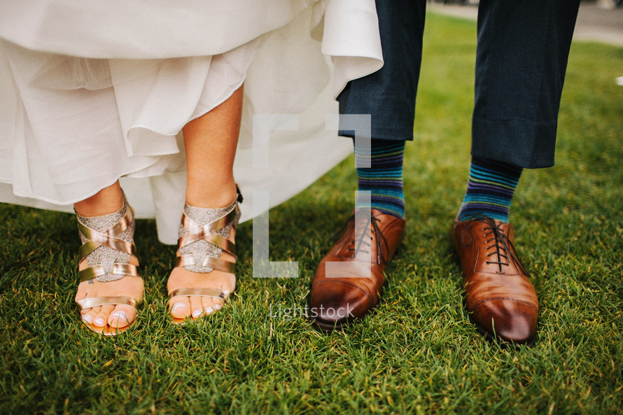 bride and grooms shoes and feet