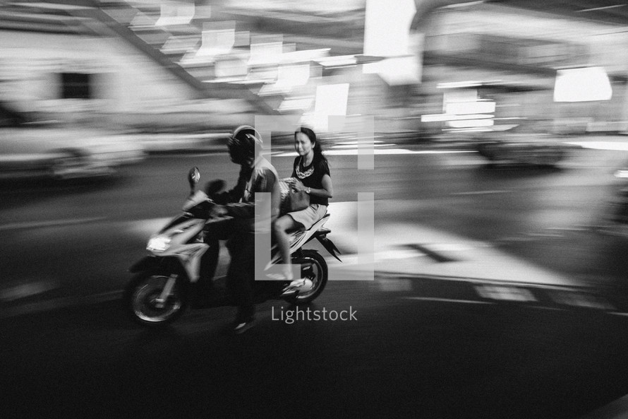 man and woman on a motorcycle in Thailand
