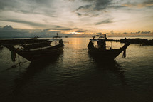 Boats anchored in a harbor in THailand.