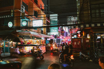 Busy city street in Thailand at night.