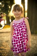 girl child outdoors in sunlight