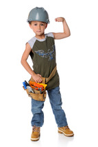 A boy wearing a tool belt and hard hat flexing his muscles.