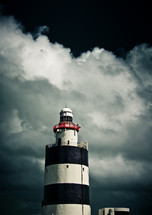 black and white lighthouse and storm clouds