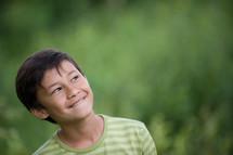A smiling boy,